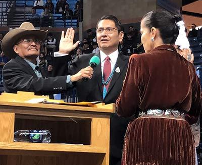 Jonathan Nez, Below Portraits of Past Shonto Leaders, takes Oath of Office