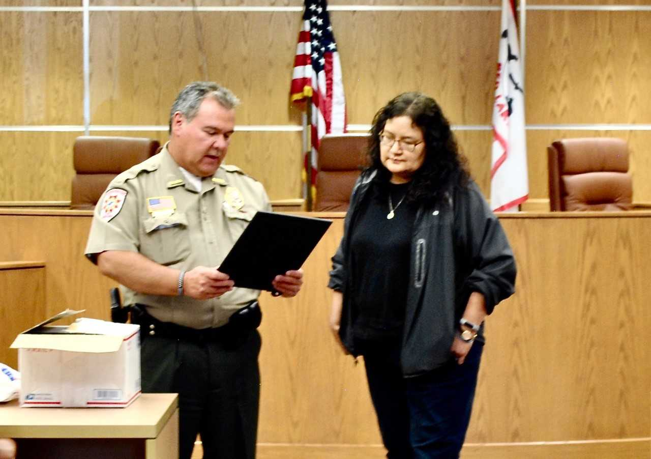 Conservation Officer Shannon Barron Family Presented Letter from AG Barr